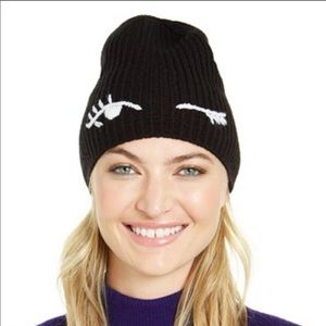 Kate Spade winking face black and white beanie